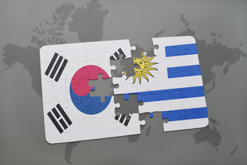 puzzle with the national flag of south korea and uruguay on a world map background.