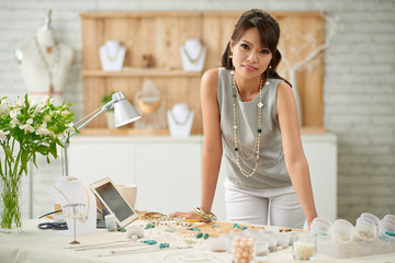 Portrait of female entrepreneur in her design studio