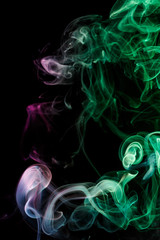 Abstract purple emerald smoke from aromatic sticks.