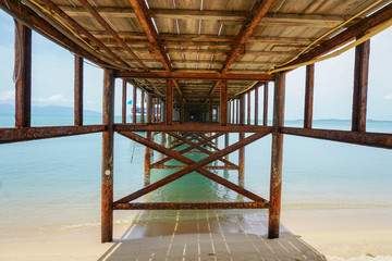 Under tropical pier at Samui island, Thailand