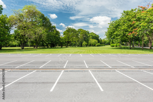 empty parking lot against green lawn in city park stock. Black Bedroom Furniture Sets. Home Design Ideas