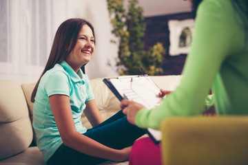 Girl teenager is happy after a successful therapy by psychologis