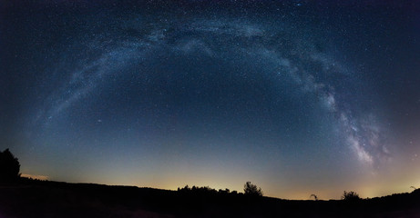 Milky Way panorama over a field