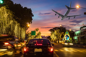 Traffic road in capital with light car and airplane flying in route beautiful festival at twilight