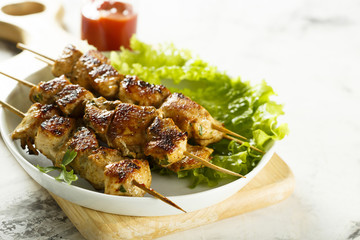 Chicken skewers with tomato sauce