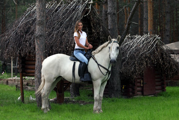 Beautiful model horseback riding in tourist camp