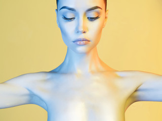 Elegant model in the light colored spotlights