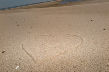 Heart on the beach drawing on the sand