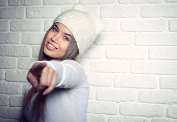 Portrait of young attractive cheerful hipster girl making funny