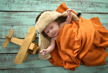 Baby boy aviator with pilot scarf and hat and handmade toy airpl