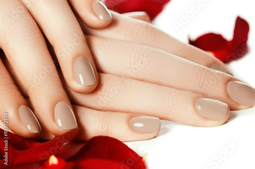 Perfect manicure. Woman hands with manicured natural beige nails ...