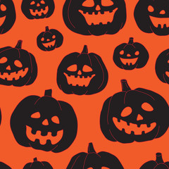 Seamless Halloween pattern with black pumpkins
