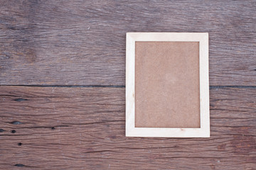 Blank wooden picture frame on wood table