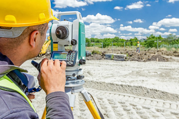 Zrenjanin, Vojvodina, Serbia - June 22, 2015: Surveyor engineer is measuring level on construction site. Geodesist is working with total station on a building site.