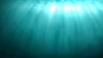 Underwater background with rays of sunlight shining down through the water surface. At the bottom, a rocky ocean floor is visible.