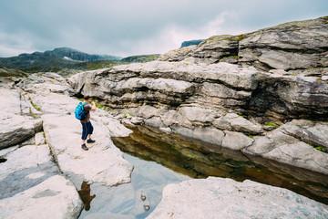Tourist Young Man Photographs Beautiful Landscape Of Norwegian Moutains