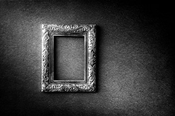 Silver vintage photo frame over grunge background, black and white, Still life style