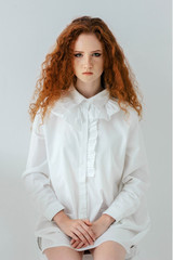 Red-haired girl in the interior