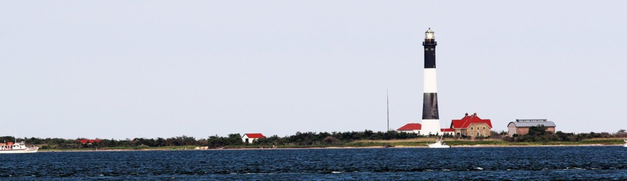 The Fire Island Lighthouse as seen from behind on a breezy day