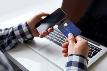 Man with credit card and mobile phone