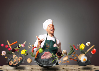 Canvas Prints Cooking Chef juggling with vegetables and other food in the kitchen