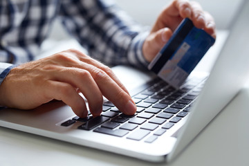 Man inserts data for online payments