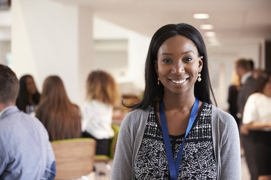 Portrait Of Female Delegate During Break At Conference