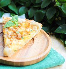 Piece of snack puff pastry pie or quiche with camembert cheese