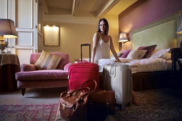 Classy woman sitting in her luxury hotel bedroom