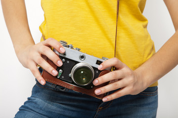 Young Woman Holding retrocamera against white background