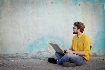 Nerd guy using a laptop
