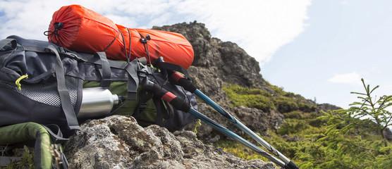 Mountain backpack,isoprene and trekking sticks equipment Wall mural