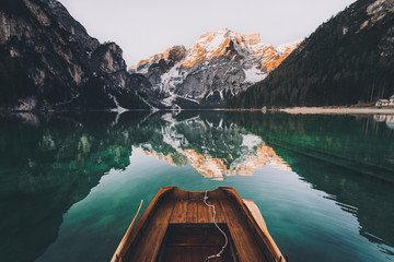 Mountains reflected in water with boat
