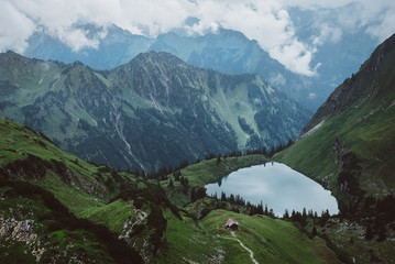 Mountains with lake and cabin, high level view
