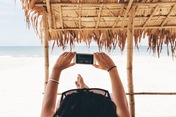 Woman Relaxing On The Beach Take Picture.