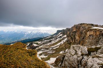 Mountain ridge under gloomy sky