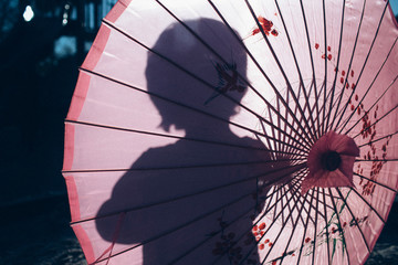 Childs silhouette through a parasol
