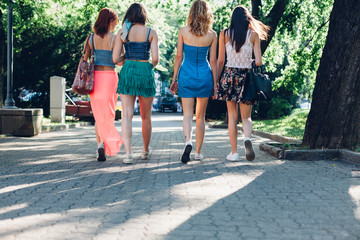 Girlfriends walking together