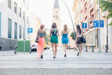 Girls pass a pedestrian crossing