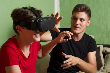 Brothers arguing over who Virtual reality glasses