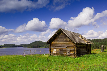 Old north Russian house on the lake shore