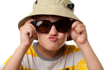 The funny little boy in sun glasses close up isolated