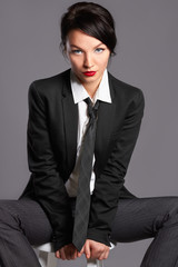 woman in formal suit and tie