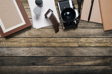 camera and supplies, Blank photo frames on wooden table