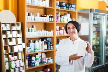 Woman pharmacist in store