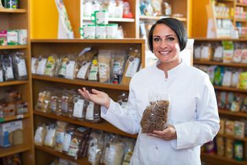mature woman seller in drugstore .