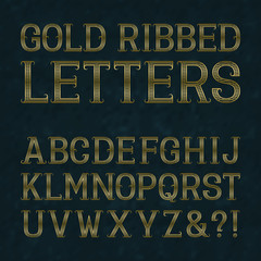 Golden ribbed letters with flourishes on blue marble surface. Horizontal stripes vintage font. Isolated latin alphabet.