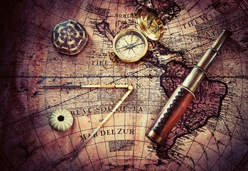 Wall Mural - Old compass and telescope on vintage map. Retro style.
