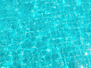 Background of Swimming Pool Water in Sunshine Day