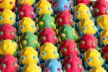 Many colorful rubber toy cars